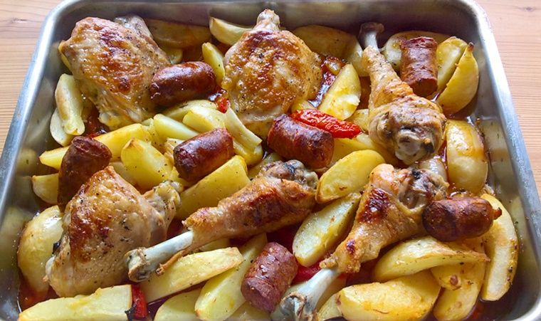 Roasted chicken legs with sausage
