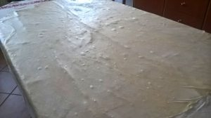 Table sized, stretched strudel dough