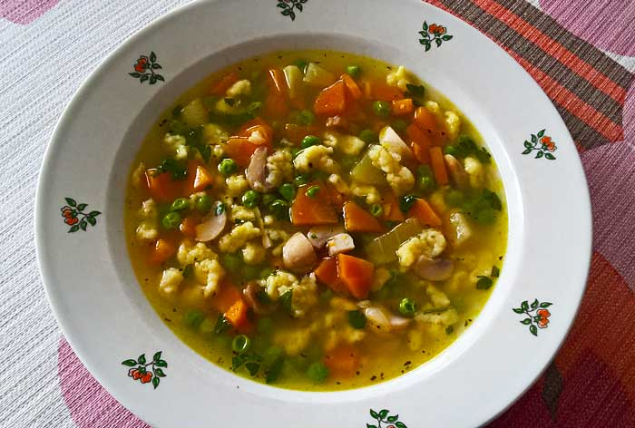 Vegetable soup with zucchini and butter dumplings